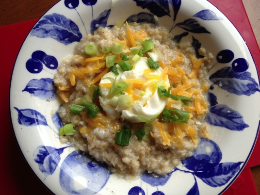 Savoury oatmeal. This version with a soft-poached egg, grated cheddar and green onions. My new favourite breakfast, still.