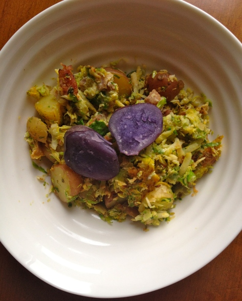 Shredded Brussels sprouts with onion, garlic, pancetta, egg and potatoes. Mmmn...